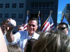 Romney signs autographs at a rooftop event at his Pa. headquarters.