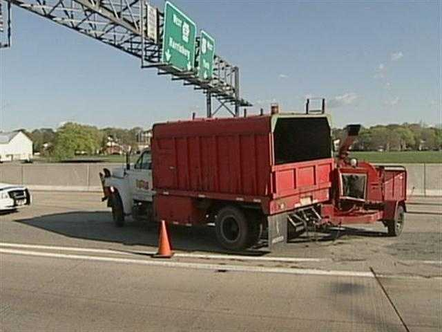 A truck hauling a wood chipper from a tree service jackknifed and turned backward.