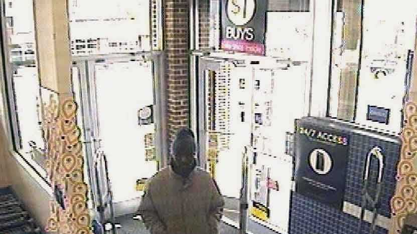 Police released this surveillance camera image of the man suspected in the robbery.