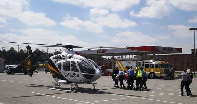 Yoe Ambulance Paramedics move the victim to a waiting helicopter. The fire happened at the Giant gas station in the background.