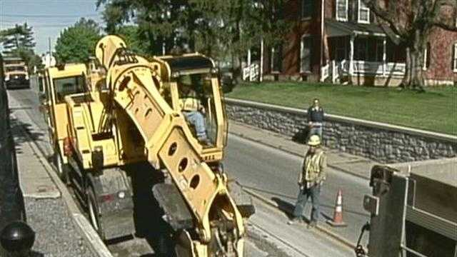 Crews work on the sinkhole Tuesday.