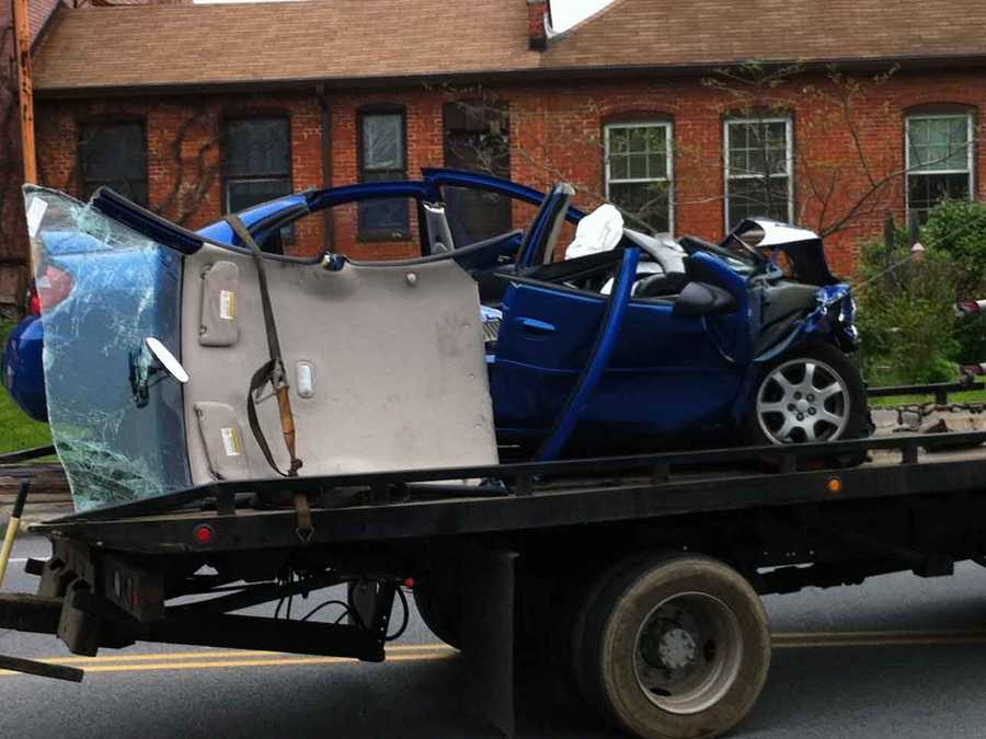 The blue Dodge Neon crossed the center line into the path of the other car, police said.