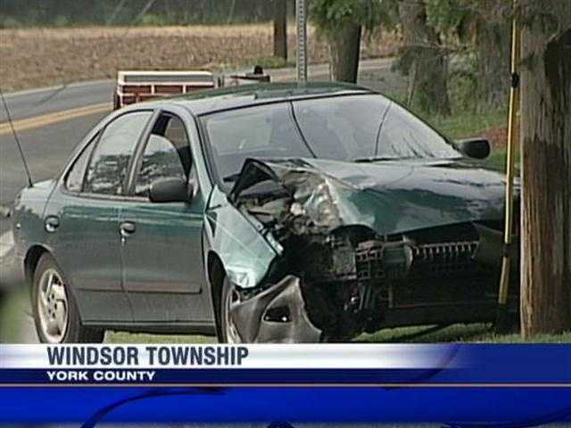 A car crashed into a utility pole and knocked down live power lines in Windsor Township, York County, on Thursday evening.