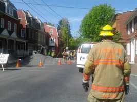 Crews working on a water line Monday morning in the 200 block of East Orange Street in Lancaster struck a 4-inch gas line.