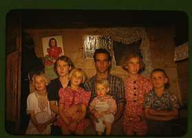 Jack Whinery, homesteader, and his family from Pie Town, New Mexico. Russell Lee took this family portrait in October 1940.
