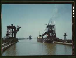 Loading a freighter with coal at one of the three coal docks owned by the Pennsylvania Railroad in Sandusky, Ohio. Jack Delano captured this image in May 1943.