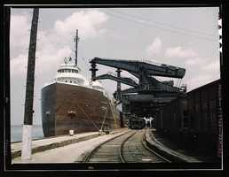 """Pennsylvania R.R. ore docks, unloading ore from a lake freighter by means of """"Hulett"""" unloaders in Cleveland, Ohio. Jack Delano took this photo in May 1943."""