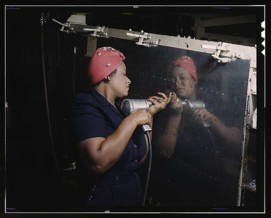 "Operating a hand drill at Vultee-Nashville, a woman is working on a ""Vengeance"" dive bomber in Tennessee. Alfred T. Palmer took this photo in February 1943."