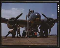Servicing an A-20 bomber in Langley Field, Va. The photo was taken by Alfred T. Palmer in July 1942.