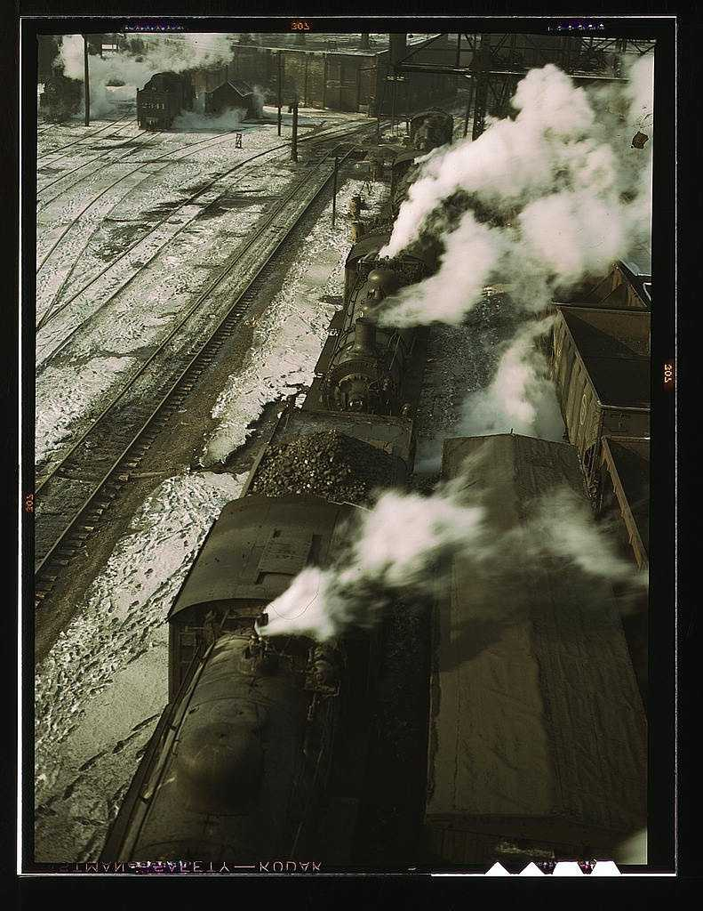 Locomotives lined up for coal, sand and water at the coaling station in the 40th Street yard of the C & NW RR., Chicago, Ill. This photo was taken in December 1942 by Jack Delano.