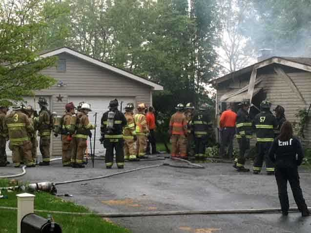 Justin Taylor crawled out of the one-story home along Cinder Road in Providence Township because the smoke was so thick. He was not hurt.