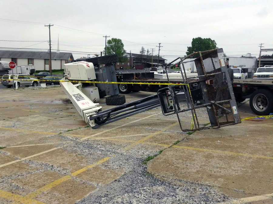 He was preparing to chain the equipment in place and then the boom lift slid or rolled off the trailer, pinning him, company officials said.