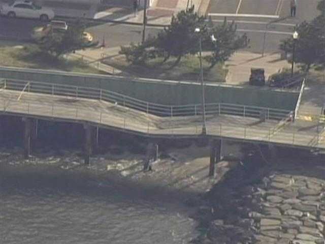 Officials said they think waves knocked some rocks loose and the rocks struck a concrete pillar under the boardwalk, causing it to collapse.
