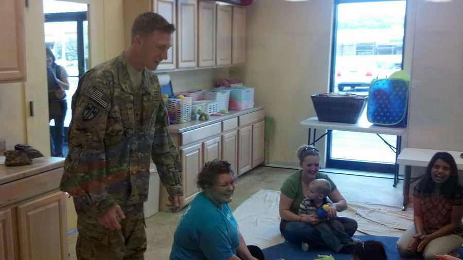 Army Specialist Todd Brecht surprised his wife, Hope, and son, Nikoali, at a Gymboree.