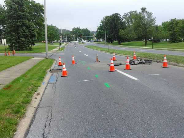The hole opened along University Drive near Route 322 and Bearcrest.