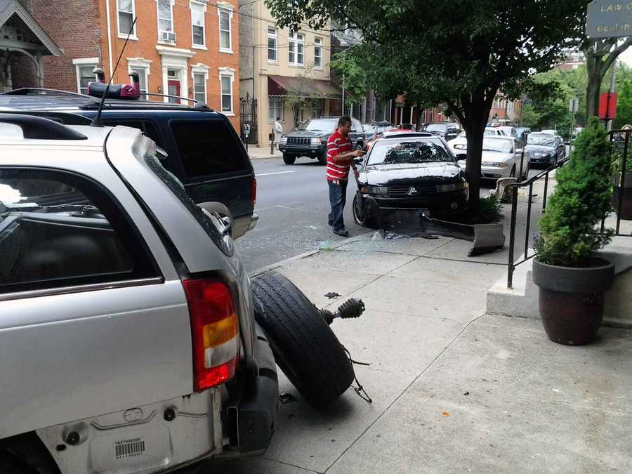 The driver of an SUV traveling east on Chestnut Street in Lancaster Tuesday morning lost control and crashed the vehicle into three parked cars.