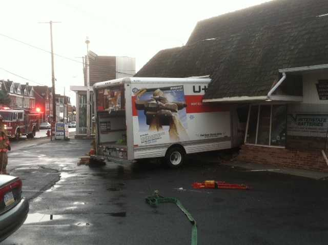 A two-vehicle crash at the intersection of Manor and Prospect streets in Lancaster ends with a U-Haul truck slamming into an auto repair shop about 7 p.m. Wednesday.