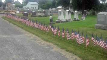 Now, he and volunteers put more than 6,400 flags in the ground to honor those killed in Iraq and Afghanistan.