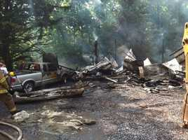 The fire caused severe damage to the barn and a pickup truck.