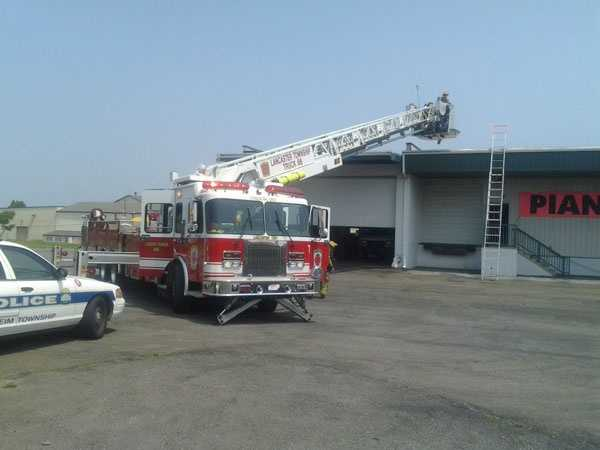 Crews were there after a small fire started in a rooftop air conditioning unit.