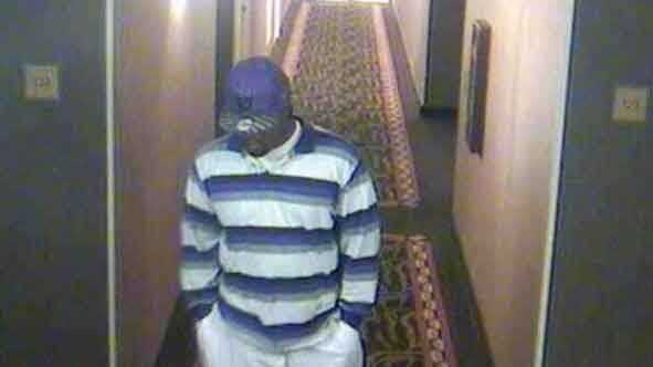 Police released this surveillance camera photo of the man suspected in the robbery.