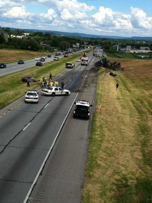 Police said a Cadillac crossed the median and hit a tractor-trailer. The driver of the Cadillac was killed. A passenger was flown to the hospital. The truck driver was not hurt.