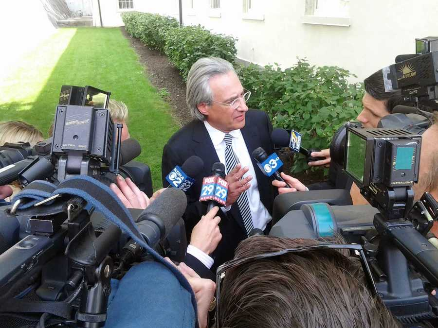 An accuser's attorney speaks to reporters.