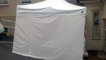This tent will help shield accusers from public view as they enter the courthouse.