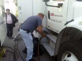 A CNN truck gets fuel.