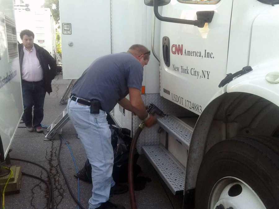 A CNN truck gets fuel.