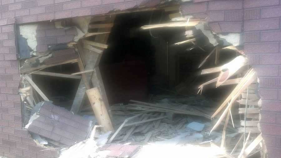 A two-vehicle crash forced the truck into the home. Click here to watch a live report.