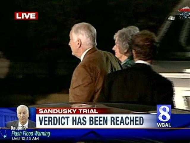 Jerry and Dottie Sandusky prepare to enter the courthouse for the verdict from the jury.
