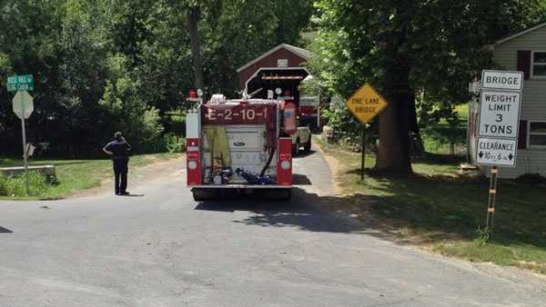 A fire truck is parked near where the body was found.