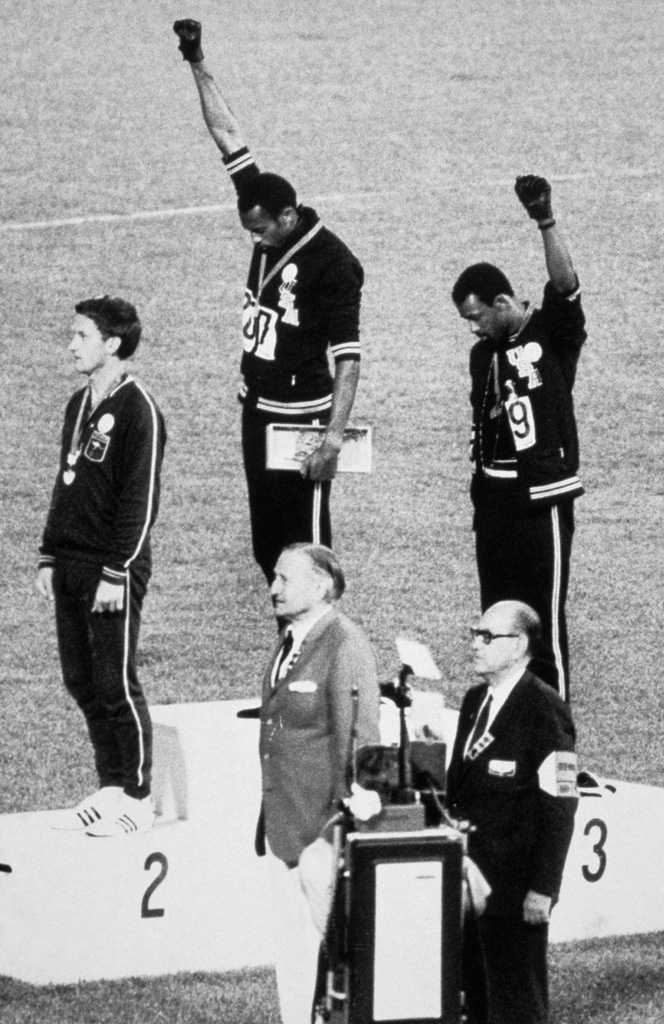 "1968 - Mexico City, Mexico: In the 200 m medal award ceremony, African-American athletes Tommie Smith and John Carlos raised their black-gloved fists as a symbol of ""Black Power"", setting a milestone for America's civil rights movement. The Australian Peter Norman, who took second, wore an American civil rights badge on the podium in support."