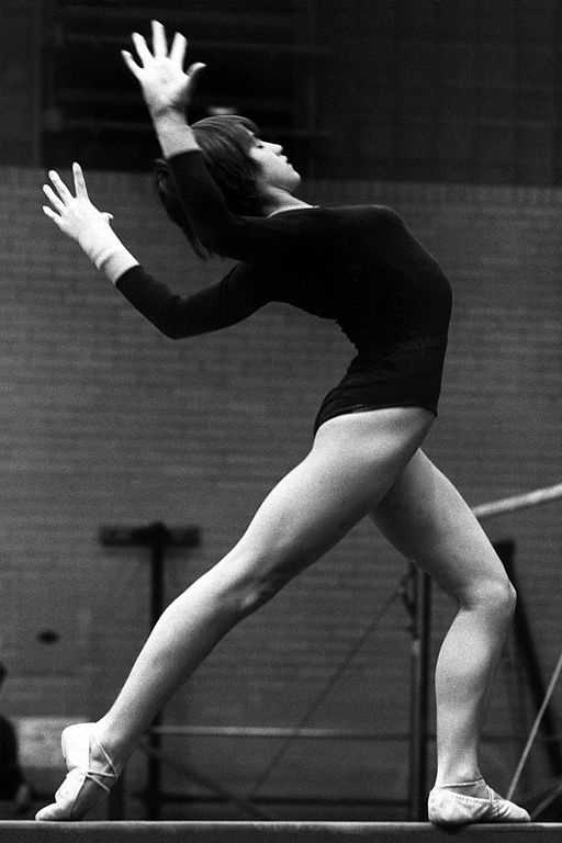 1976 - Montreal, Canada: At age 14, Romanian gymnast Nadia Comaneci scored seven perfect 10.0's and won three gold medals, including the prestigious All Around. The scoreboard could hold only 3 digits and the score was shown as 1.00.