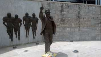 A few items have been left at the statue of Joe Paterno outside Beaver Stadium on Penn State's main campus.
