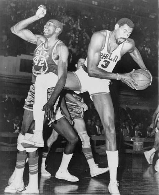 Chamberlain (right) was one of 37 blacks in the league in 1962 who were transforming the game to be played faster and above the rim.