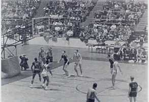 In 1962, the NBA still wasn't recognized as a major league sport and often struggled to compete against college basketball in generating a fanbase. This picture is a still from a 1962 NBA game.