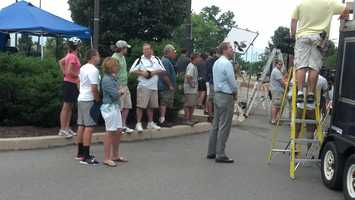 Visitors gather after the statue of former coach Joe Paterno was removed.