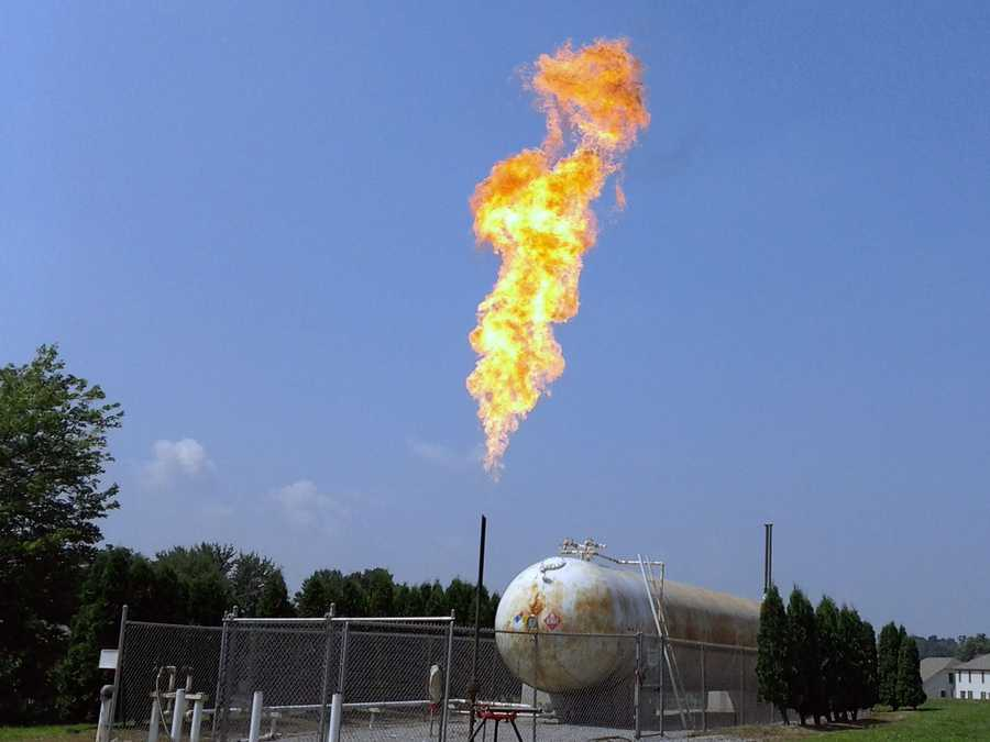 Crews emptied a tank of propane liquid, but gas still remained. So, they must burn it off.