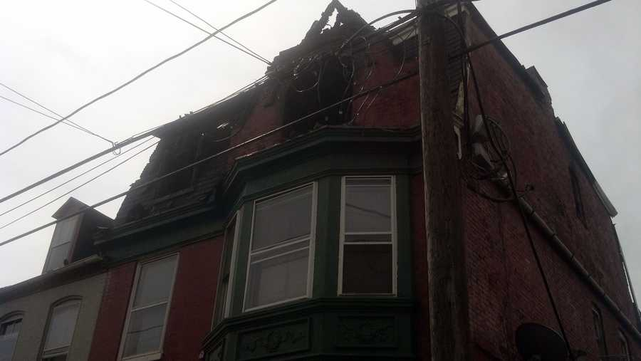 Fire fighters said they had to urge one woman, trapped upstairs, to throw her baby out the window to safety.