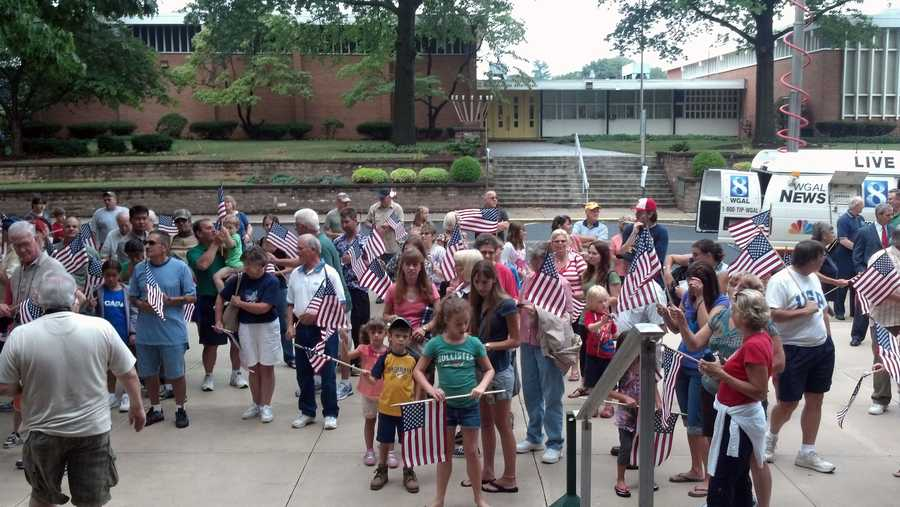 People gather in front of the Lebanon County courthouse Tuesday to honor two Olympic athletes from the area.