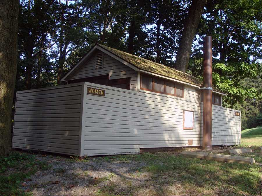 Restrooms with non-flush toilets are located at several places in the park.