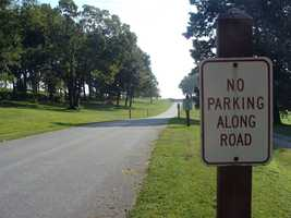 The park has several parking lots. Parking is not permitted along the road.