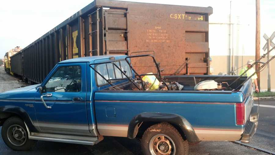 The driver said as he was crossing the tracks the pickup was struck by the slow moving train.