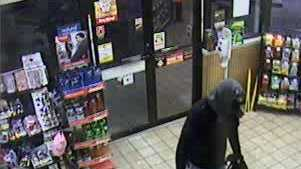 Police released two surveillance photos of the robbery suspects.