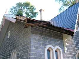 The roof and some lattice work were damaged. The structure was built around 1860.