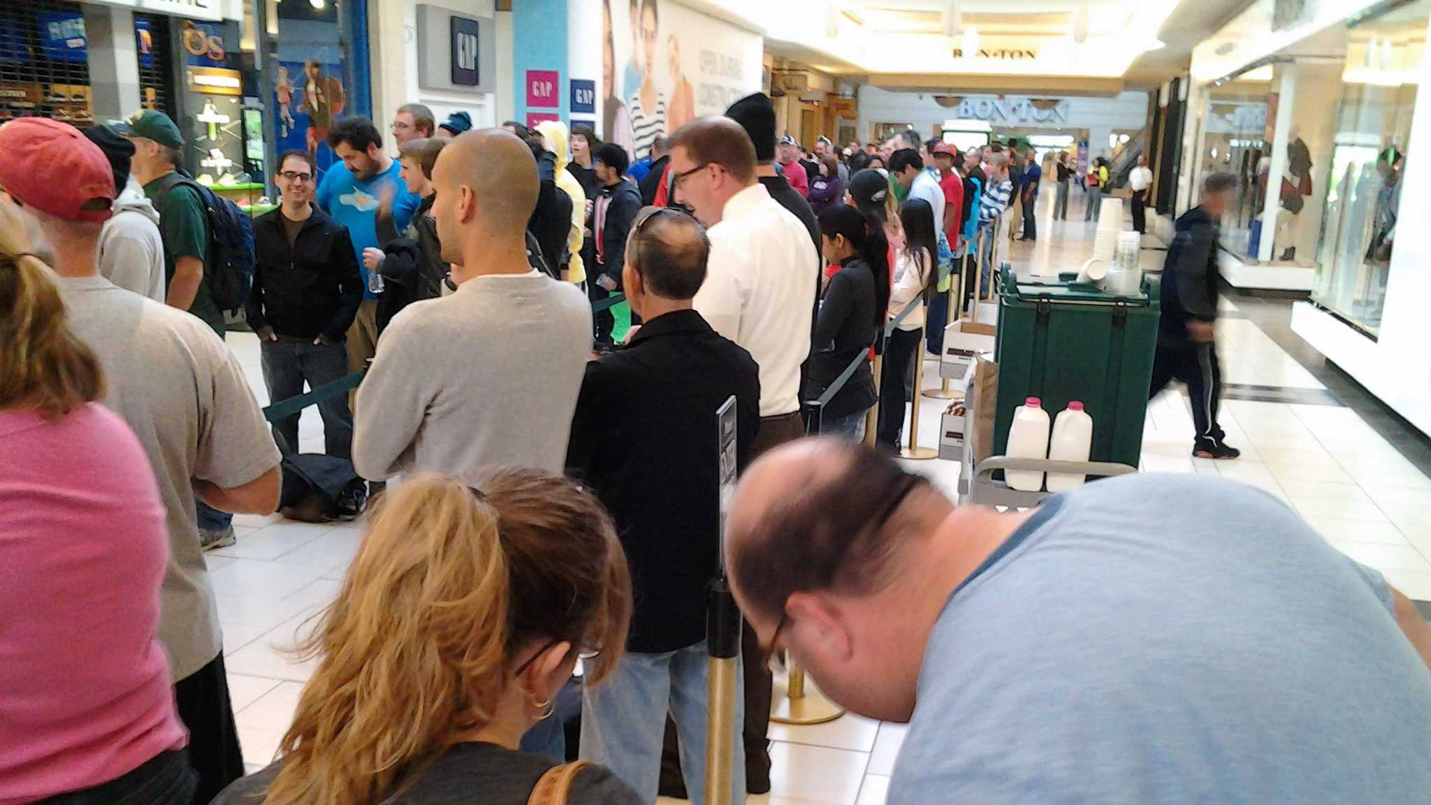 Customers gather in front of the Apple store at Park City Center in Lancaster on Friday morning.