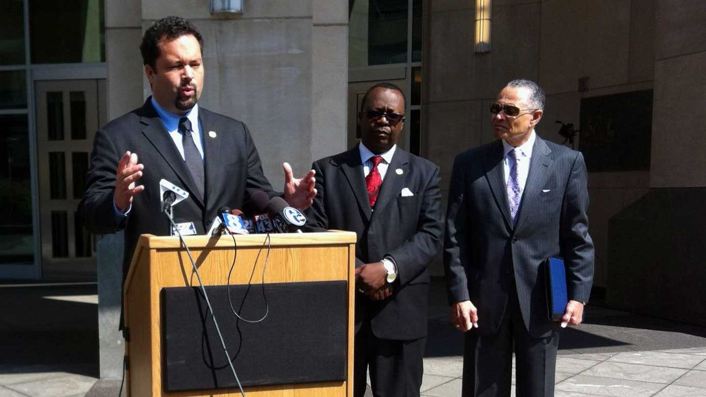 NAACP President Benjamin Jealous talks to reporters outside of the Pa. Judicial Center in Harrisburg during a recess in the Commonwealth Court hearing on the voter ID law.