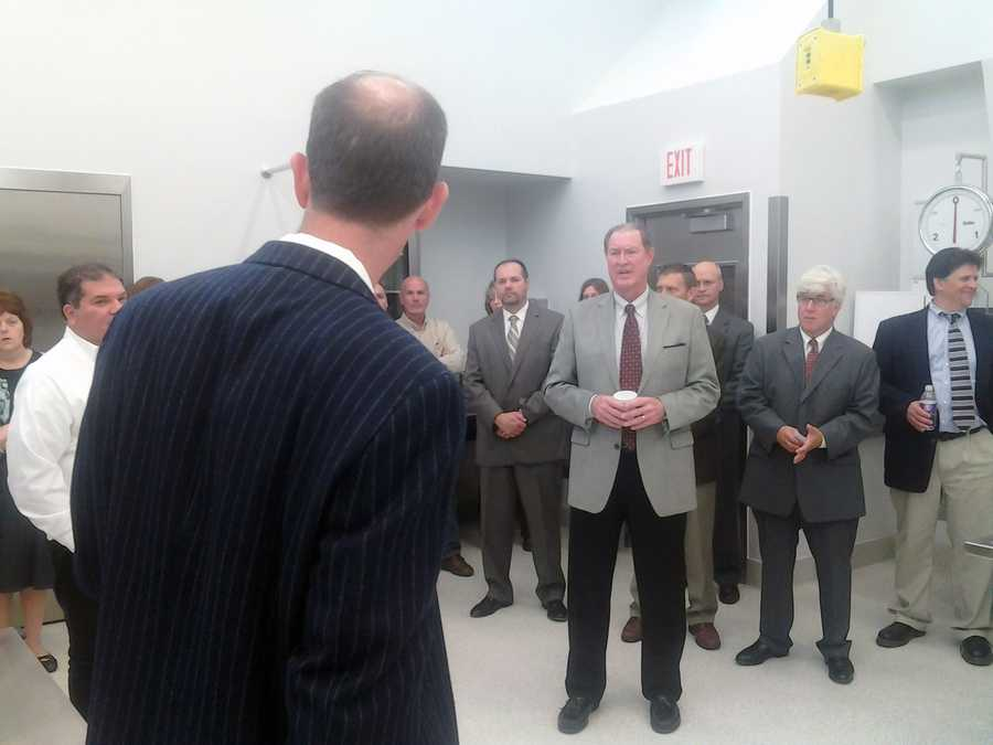 Officials tour the forensic center the day it was dedicated.